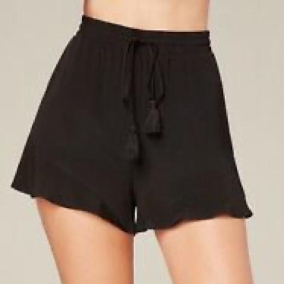 Bebe Tassel Tie Waist Ruffle Shorts